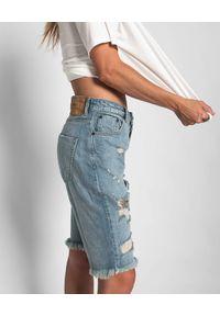 ONETEASPOON - Jeansowe spodenki Kansas Truckers. Stan: podwyższony. Kolor: niebieski. Materiał: jeans. Długość: do kolan. Wzór: aplikacja. Styl: rockowy