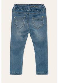Niebieskie jeansy Name it w kolorowe wzory