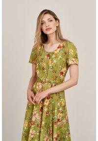 Marie Zélie - Sukienka Rosa Bouquet zielona. Typ kołnierza: kokarda. Kolor: zielony. Materiał: tkanina, wiskoza, len, materiał. Długość rękawa: krótki rękaw. Długość: midi