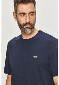 Lacoste - T-shirt/polo TH2038. Okazja: na co dzień. Typ kołnierza: polo. Kolor: niebieski. Materiał: dzianina. Wzór: gładki, aplikacja. Styl: casual