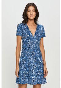 Niebieska sukienka Tommy Jeans z krótkim rękawem, mini, rozkloszowana