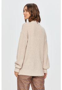 Kremowy sweter TOMMY HILFIGER długi, na co dzień