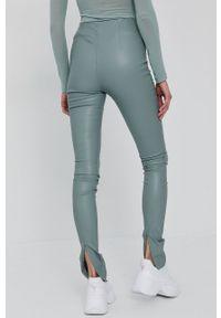 Nissa - NISSA - Spodnie. Stan: podwyższony. Kolor: niebieski. Materiał: tkanina