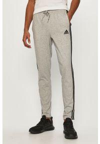 Szare spodnie dresowe Adidas gładkie