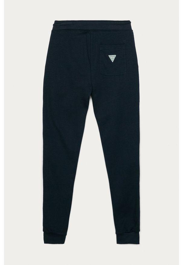 Niebieskie spodnie dresowe Guess Jeans z aplikacjami