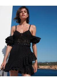 CHARO RUIZ IBIZA - Czarna sukienka mini Denisse. Kolor: czarny. Materiał: koronka. Długość rękawa: na ramiączkach. Wzór: ażurowy, koronka. Sezon: lato. Typ sukienki: dopasowane, asymetryczne, z odkrytymi ramionami. Styl: wakacyjny. Długość: mini