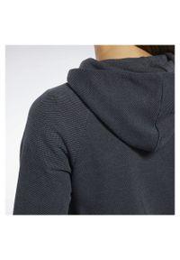 Bluza damska Reebok Training Essentials FJ2732. Typ kołnierza: kaptur. Materiał: poliester, bawełna, materiał. Długość rękawa: raglanowy rękaw