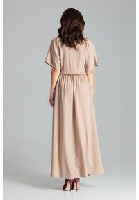 Lenitif - Długa rozkloszowana sukienka oversize kopertowy dekolt beż. Okazja: na co dzień, na imprezę. Typ kołnierza: dekolt kopertowy. Kolor: beżowy. Typ sukienki: kopertowe, oversize. Styl: elegancki, casual. Długość: maxi