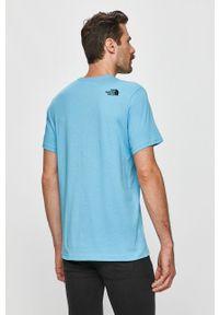 Niebieski t-shirt The North Face na co dzień, casualowy, z nadrukiem