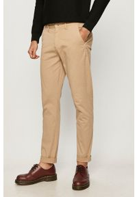 Guess - Spodnie. Kolor: beżowy. Materiał: tkanina