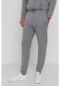 Guess - Spodnie. Kolor: szary. Materiał: dzianina, bawełna