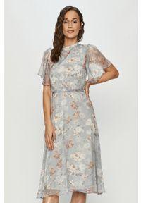 Niebieska sukienka Vila ze stójką, rozkloszowana