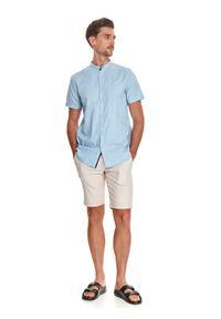 TOP SECRET - Koszula ze stójką. Typ kołnierza: kołnierzyk stójkowy. Kolor: niebieski. Materiał: bawełna, tkanina. Długość rękawa: krótki rękaw. Długość: krótkie. Wzór: kropki. Sezon: lato. Styl: elegancki