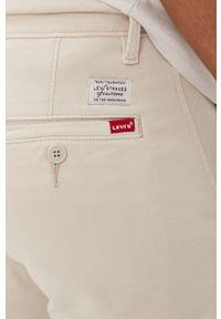 Levi's® - Levi's - Spodnie. Okazja: na spotkanie biznesowe. Kolor: szary. Materiał: tkanina, bawełna. Wzór: gładki. Styl: biznesowy