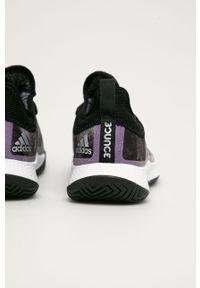 Czarne buty sportowe adidas Performance na średnim obcasie, z okrągłym noskiem