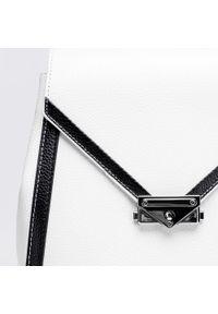 Wittchen - Damski plecak skórzany z kopertową klapą. Kolor: wielokolorowy, biały, czarny. Materiał: skóra. Wzór: paski. Styl: klasyczny, elegancki