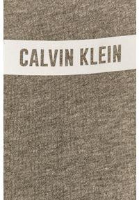 Calvin Klein Performance - Bluza bawełniana. Okazja: na co dzień. Typ kołnierza: kaptur. Kolor: szary. Materiał: bawełna. Długość rękawa: długi rękaw. Długość: długie. Wzór: nadruk. Styl: casual