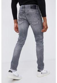 Cross Jeans - Jeansy bawełniane Tapered. Kolor: szary