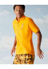 Lacoste - LACOSTE - Żółta koszulka polo z logo Regular Fit. Typ kołnierza: polo. Kolor: żółty. Materiał: bawełna. Wzór: haft, prążki, aplikacja