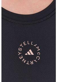 Adidas by Stella McCartney - adidas by Stella McCartney - T-shirt. Kolor: czarny. Materiał: dzianina, poliester. Wzór: gładki