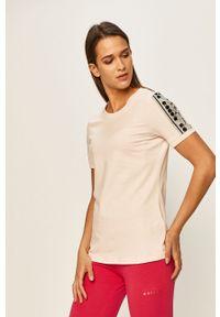 Różowa bluzka Diadora z aplikacjami, casualowa, na co dzień