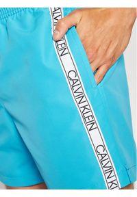 Calvin Klein Swimwear Szorty kąpielowe Drawstring KM0KM00558 Niebieski Regular Fit. Kolor: niebieski