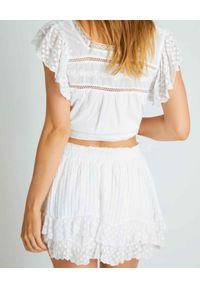 LOVE SHACK FANCY - Biała spódnica z falbanką. Kolor: biały. Materiał: bawełna, koronka, wełna. Wzór: haft, kropki, koronka, aplikacja. Sezon: lato