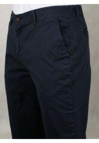 Ranir - Granatowe Męskie Spodnie Casualowe -RANIR- Bawełniane, Chinosy. Okazja: na co dzień. Kolor: niebieski. Materiał: lycra, bawełna. Styl: casual