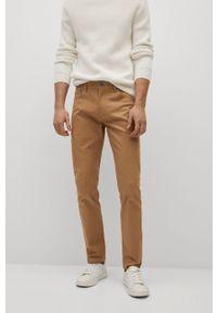 Mango Man - Spodnie PISA. Kolor: beżowy. Materiał: dzianina, bawełna. Wzór: gładki