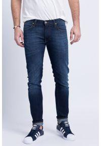 Niebieskie jeansy Lee z aplikacjami