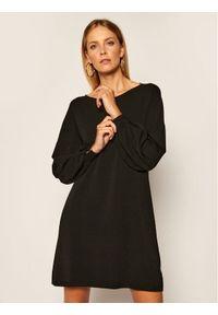 TwinSet - Dzianinowa sukienka Twinset (Outlet). Kolor: czarny. Materiał: dzianina. Wzór: aplikacja. Typ sukienki: oversize