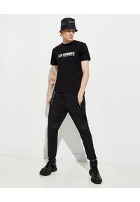 Les Hommes - LES HOMMES - Czarny kapelusz z nylonu. Kolor: czarny. Materiał: nylon. Wzór: aplikacja