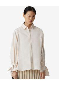 Kenzo - KENZO - Beżowa koszula z wiązaniem. Kolor: beżowy. Długość rękawa: długi rękaw. Długość: długie. Wzór: aplikacja. Styl: klasyczny