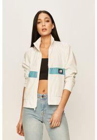Biała kurtka New Balance raglanowy rękaw, bez kaptura