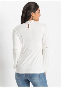 Shirt z koronką i długim rękawem bonprix biel wełny. Typ kołnierza: kołnierzyk stójkowy. Kolor: biały. Materiał: koronka, wełna. Długość rękawa: długi rękaw. Długość: długie. Wzór: koronka
