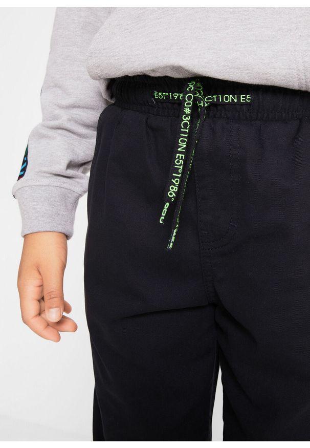 Czarne spodnie bonprix z napisami