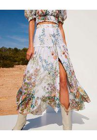 CHARO RUIZ IBIZA - Długa spódnica z rozcięciem Ann. Stan: podwyższony. Kolor: biały. Materiał: bawełna. Długość: długie. Wzór: kwiaty, geometria, aplikacja
