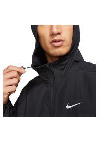 Kurtka męska wodoodporna do biegania Nike Repel Miler DD4746. Typ kołnierza: kaptur. Materiał: włókno, materiał, poliester. Sport: fitness