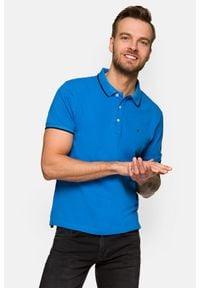 Lancerto - Koszulka Niebieska Polo Dominic. Typ kołnierza: polo. Kolor: niebieski. Materiał: materiał, tkanina, bawełna, włókno. Długość rękawa: krótki rękaw. Wzór: ze splotem. Styl: klasyczny
