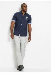 Koszula z krótkim rękawem i nadrukiem bonprix ciemnoniebieski. Kolor: niebieski. Długość rękawa: krótki rękaw. Długość: krótkie. Wzór: nadruk
