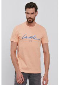 Lacoste - T-shirt. Okazja: na co dzień. Kolor: pomarańczowy. Wzór: nadruk. Styl: casual