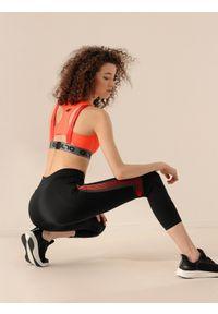4f - Legginsy treningowe damskie Anna Lewandowska x 4F. Stan: podwyższony. Kolor: czarny. Materiał: mesh, materiał. Wzór: gładki, nadruk. Sport: fitness
