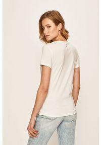 Only Play - T-shirt. Okazja: na co dzień. Kolor: biały. Materiał: dzianina, bawełna. Wzór: nadruk. Styl: casual #2