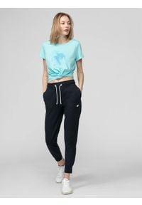 4f - Spodnie dresowe damskie. Kolor: niebieski. Materiał: dresówka. Sport: fitness