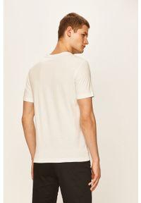 Biały t-shirt Puma casualowy, z nadrukiem, na co dzień
