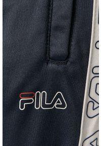 Niebieskie spodnie dresowe Fila z aplikacjami