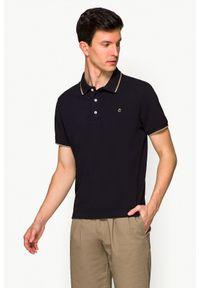 Lancerto - Koszulka Ciemnogranatowa Polo Dominic. Typ kołnierza: polo. Kolor: niebieski. Materiał: włókno, materiał, bawełna. Długość rękawa: krótki rękaw. Wzór: ze splotem. Styl: klasyczny