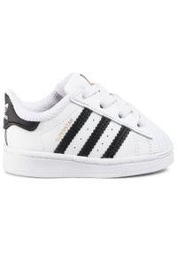 Adidas - Buty adidas - Superstar El I FU7717 Ftwwht/Cblack/Ftwwht. Okazja: na urodziny, na co dzień. Zapięcie: pasek. Kolor: biały. Materiał: skóra ekologiczna, skóra. Szerokość cholewki: normalna. Wzór: paski. Styl: młodzieżowy, vintage, sportowy, klasyczny, casual