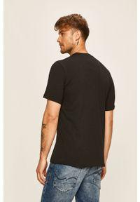 Czarny t-shirt Reebok Classic z nadrukiem, na co dzień