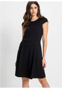 Sukienka biznesowa bonprix czarny. Okazja: na spotkanie biznesowe. Kolor: czarny. Styl: biznesowy